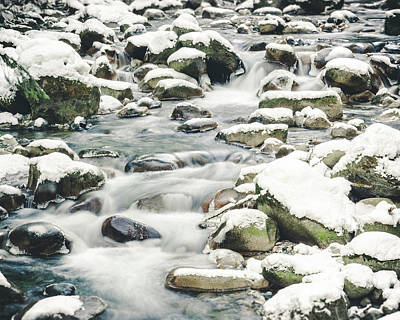 Photograph - Winter Long Exposure River Water Flowing In Snow Covered Rocks by Open Range