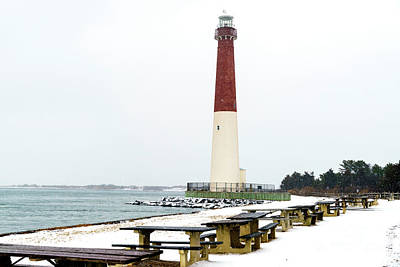 Photograph - Winter Snow At Barnegat Lighthouse by John Rizzuto
