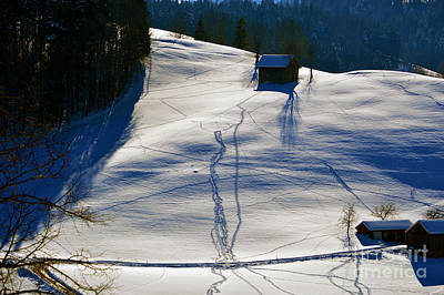 Barns In Snow Photograph - Winter Wonderland In Switzerland - Tracks In The Snow by Susanne Van Hulst