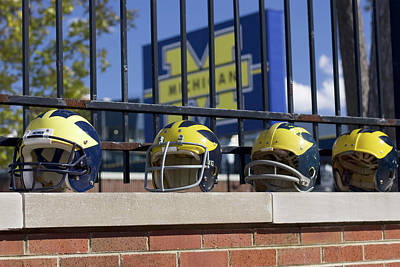 Photograph - Wolverine Helmets Of Different Eras On Stadium Wall by Michigan Helmet