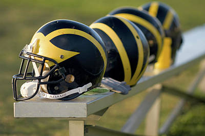 Photograph - Wolverine Helmets On A Bench by Michigan Helmet
