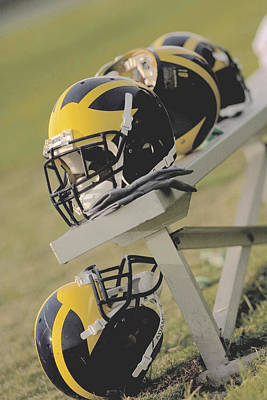 Photograph - Wolverine Helmets On A Football Bench by Michigan Helmet