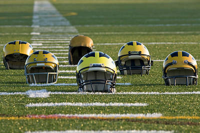 Photograph - Wolverine Helmets Throughout History On The Field by Michigan Helmet