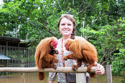 Red Monkey Photograph - Woman And Bald Uakari Monkeys by Jess Kraft
