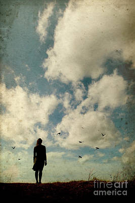 Photograph - Woman And Birds With Dramatic Sky by Clayton Bastiani