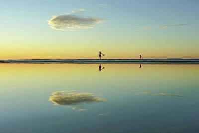 Woman And Cloud Reflected On Beach Lagoon At Sunset Art Print