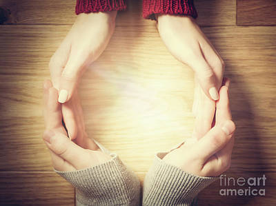 Photograph - Woman And Man Making Circle With Hands. Warm Light Inside by Michal Bednarek