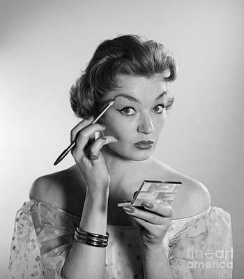 Woman Applying Makeup, C.1950-60s Art Print by Corry/ClassicStock