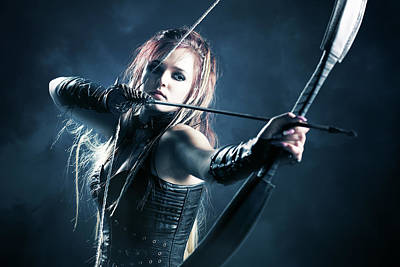 Royalty Free Images - Woman archer aiming arrow Royalty-Free Image by Johan Swanepoel