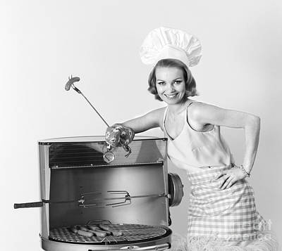 Photograph - Woman At Grill, C.1960s by H. Armstrong Roberts/ClassicStock