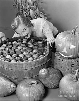 Woman Bobbing For Apples, C.1950s Art Print by H. Armstrong Roberts/ClassicStock