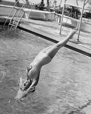 Swimsuit Photograph - Woman Doing A Back Dive by Underwood Archives
