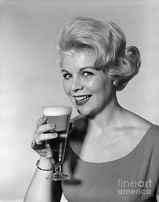 Woman Drinking Beer, C.1960s Art Print by H. Armstrong Roberts/ClassicStock