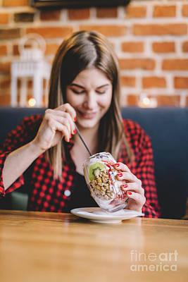 Photograph - Woman Eating Healthy Sweet Snack by Michal Bednarek