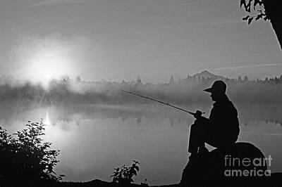Photograph - Woman Fishing From Rock by Jim Corwin