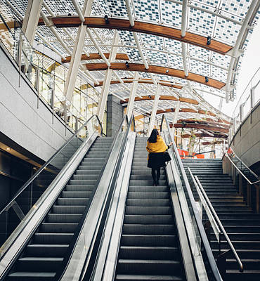 Woman Going Up Escalator In Milan, Italy Art Print