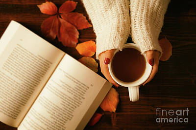 Woman Hands Holding Teacup And Opened Book Seen From Above Art Print