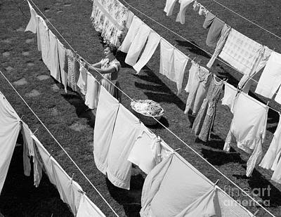 Woman Hanging Laundry, C.1950s Art Print by Debrocke/ClassicStock