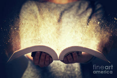 Photograph - Woman Holding An Open Book Bursting With Light. by Michal Bednarek