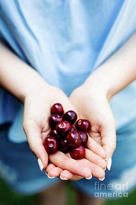 Photograph - Woman Holding Cherries In Her Hands. by Michal Bednarek