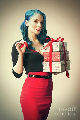 Woman Holding Christmas Presents Art Print by Amanda Elwell
