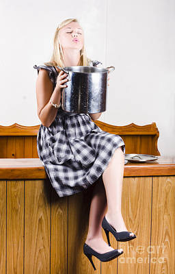 Woman Holding Hot Cooking Pot In Kitchen Art Print
