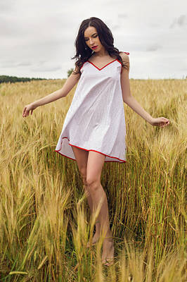 From The Kitchen - Woman In A Red Light Dress Stands In A Field by Elena Saulich