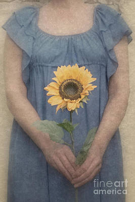 Photograph - Woman In Blue Dress Holding Sunflower by Clayton Bastiani