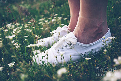 Photograph - Woman In Sneakers Standing On Meadow With Flowers. by Michal Bednarek