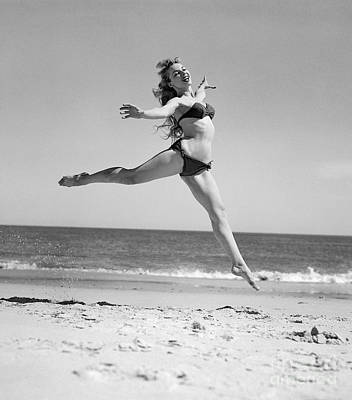 Photograph - Woman Leaping On The Beach, C.1950s by H Armstrong Roberts and ClassicStock