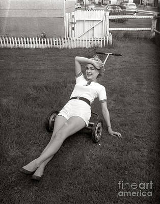 Woman Lounging On Lawnmower, C.1950s Art Print by Debrocke/ClassicStock