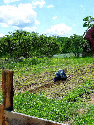 Country Life Photograph - Woman Planting Garden Near Barn by Susan Savad