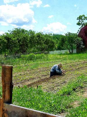 Photograph - Woman Planting Garden Near Barn by Susan Savad