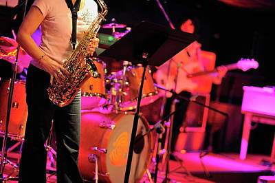 Saxophone Photograph - Woman Playing Saxophone On Stage With Her Band by Sami Sarkis