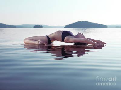 Woman Doing Yoga Photograph - Woman Practicing Yoga On The Water Fish Pose Matsyasana by Awen Fine Art Prints