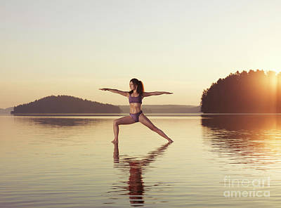 Woman Doing Yoga Photograph - Woman Practicing Yoga On The Water Veerabhadrasana Warrior Pose by Awen Fine Art Prints