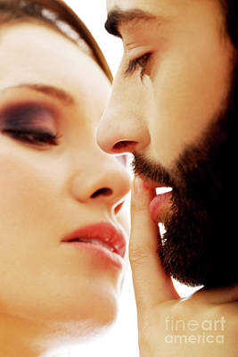 Woman Putting Her Finger On Man's Lips Print by Piotr Marcinski