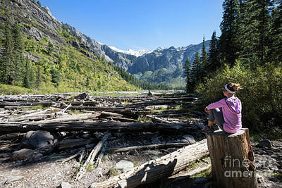 Cedar Park Photograph - Woman Relaxing At Avalanche Lake In Glacier National Park by Brandon Alms