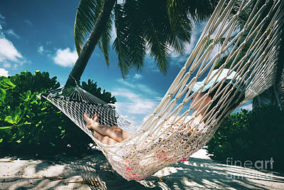 Photograph - Woman Relaxing In The Shade Of Palms On A Hammock. by Michal Bednarek