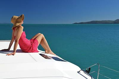 Photograph - Woman Relaxing On Sailing Boat In Whitsundays by Keiran Lusk