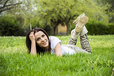 Woman Relaxing On The Grass In Springtime Art Print