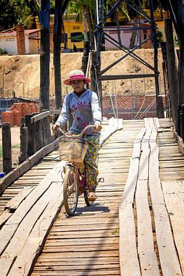 Rickety Bridge Photograph - Woman Riding Across A Bridge by Georgia Fowler