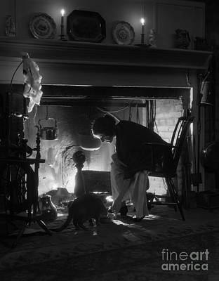 Pet Care Photograph - Woman Sitting By Fireplace, C.1920s by H. Armstrong Roberts/ClassicStock