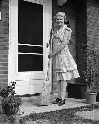 Woman Smiling With Broom, C.1940s Art Print by H. Armstrong Roberts/ClassicStock