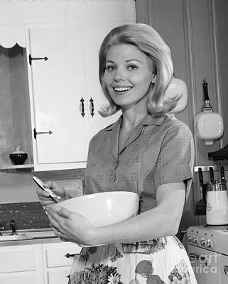 Mixing Bowls Photograph - Woman Smiling With Mixing Bowl by H. Armstrong Roberts/ClassicStock