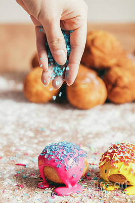 Photograph - Woman Sprinkling Sugar Strands On Doughnuts by Michal Bednarek