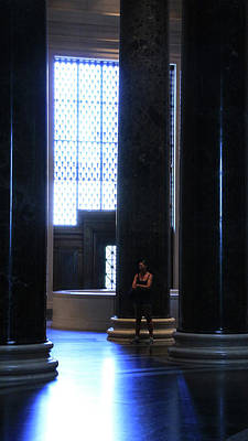 Photograph - Woman Standing In The Dark With Tall Dark Columns by Cora Wandel