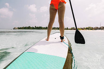 Photograph - Woman Standing On A Surfing Board by Michal Bednarek