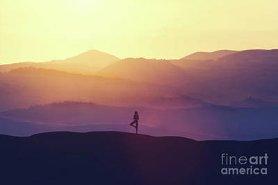 Photograph - Woman Standing On The Hill, Practicing Yoga. by Michal Bednarek