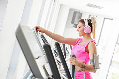 Photograph - Woman Starting Crosstrainer Workout In A Gym. by Michal Bednarek